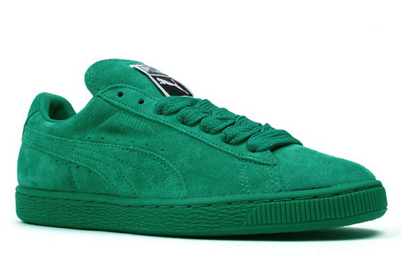 green suede puma sneakers