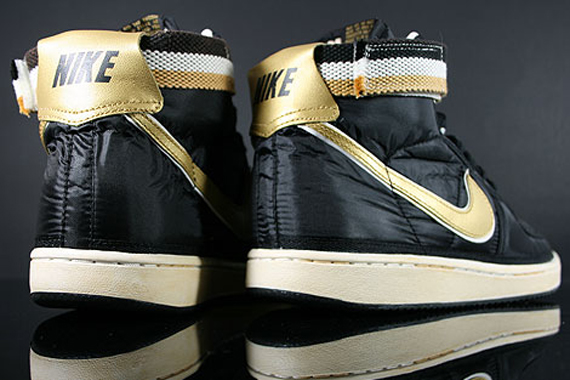 black and gold nike high tops