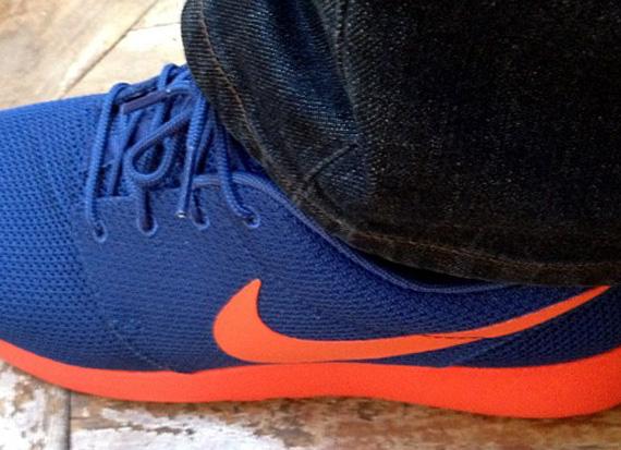 Blue and orange roshe runs