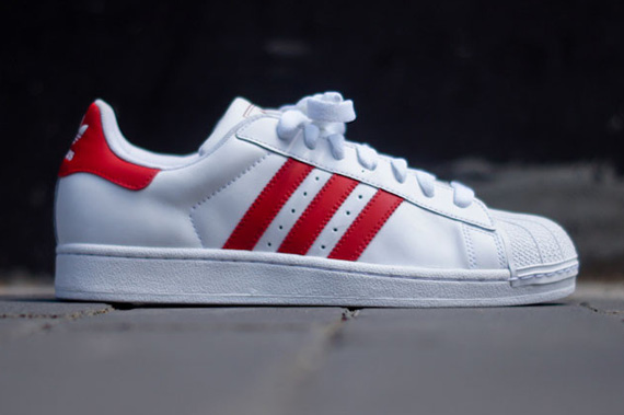 a86c102df58473 The adidas Originals Superstar II switches navy blue branding for red