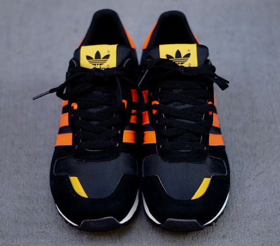 buy online c9858 6e673 adidas Originals ZX 700 - Black - Orange - Yellow   Available -  SneakerNews.com