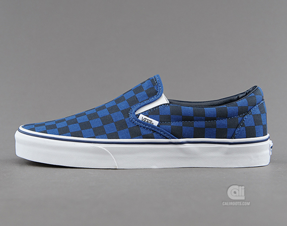 vans blue checkerboard slip ons