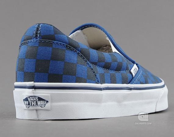 dark blue checkerboard slip on vans