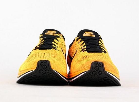 uk availability b26e1 126d6 Nike Flyknit Racer - Yellow - Black - SneakerNews.com