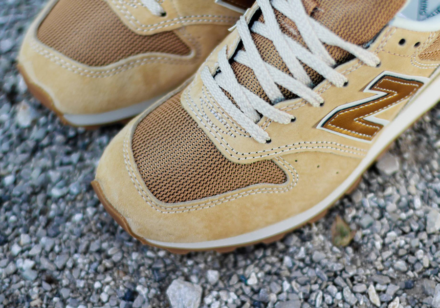 new balance 996 gold logo