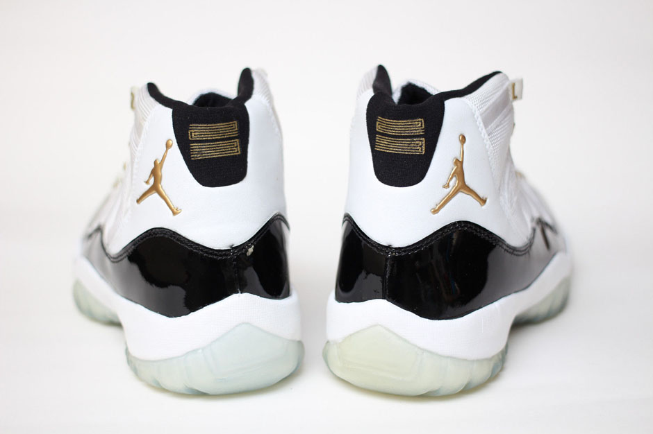 new arrival 58d80 ced63 ... coupon code for air jordan 11 dmp gold eyelet sample on ebay  sneakernews f7f04 8f2a7