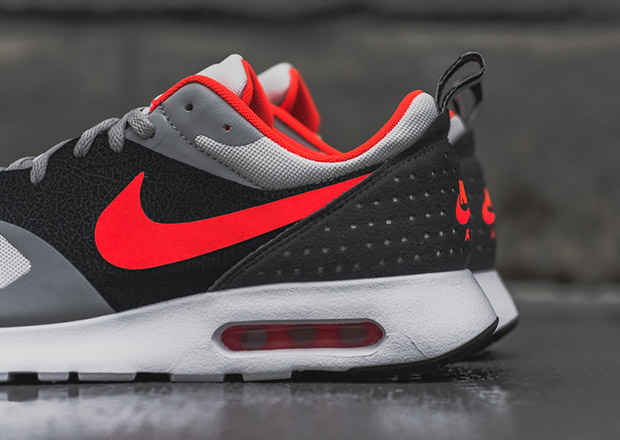 finest selection 0a200 2b0d1 ... Anthracite quarter panels, all completed with hits of vibrant Bright  Crimson. The Air Max Tavas is arriving now at select Nike sportswear  locations, ...
