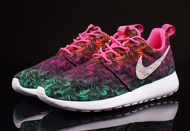 ... the Nike Roshe Run, decked out with a multi-colored and floral-printed  upper. Along with the colorful upper are speckled Swooshes and hot pink  accents, ...