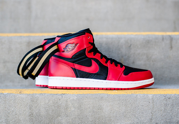 huge discount d7563 c660f ... straps on or off in the comments below, and find the Air Jordan 1 High  Strap Black Gym Red now at select Jordan Brand retailers like Sneaker  Politics.