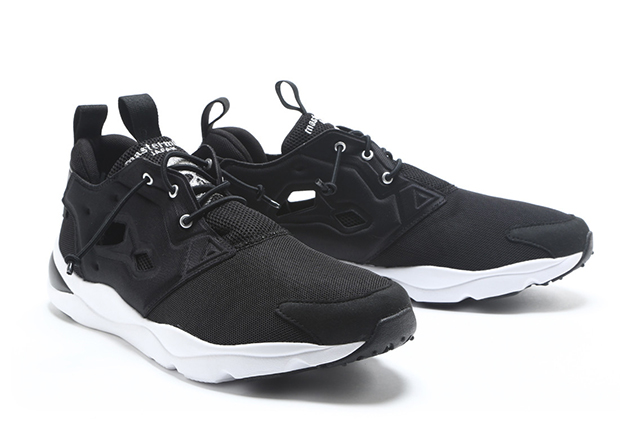 uk availability db82c 827cf Mastermind Continues Their Blacked-Out Reebok Collabs With the Furylite