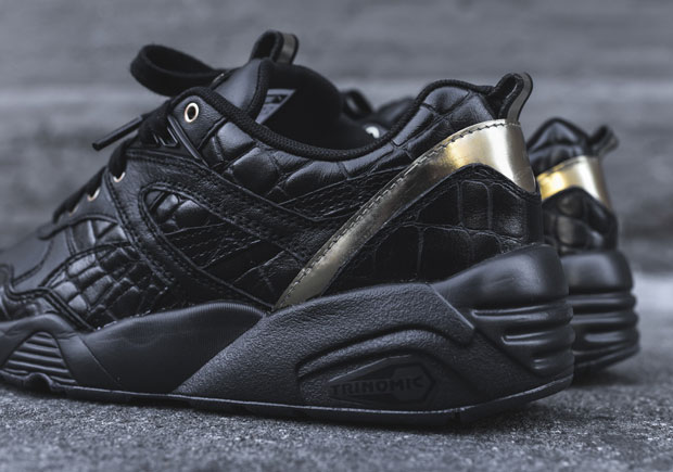 It's a new year, but not much has changed in sneaker trends, as we can see  here by yet another mostly black, reptile-embossed leather sneaker.