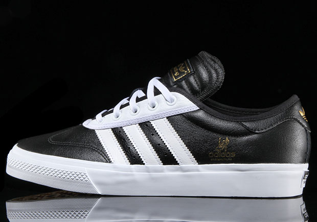 buy online f1c3f ee342 ... soft leather uppers in two colorways of blackwhite and whitered with  a gum sole. The premium adi-Ease Universal is rolling in to select adidas  ...