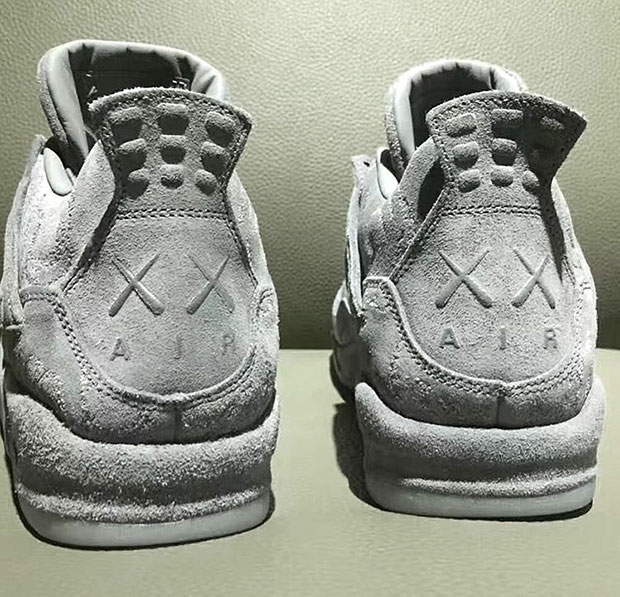 promo code e5bcf 72cea KAWS Jordan 4 Grey Suede First Look | SneakerNews.com
