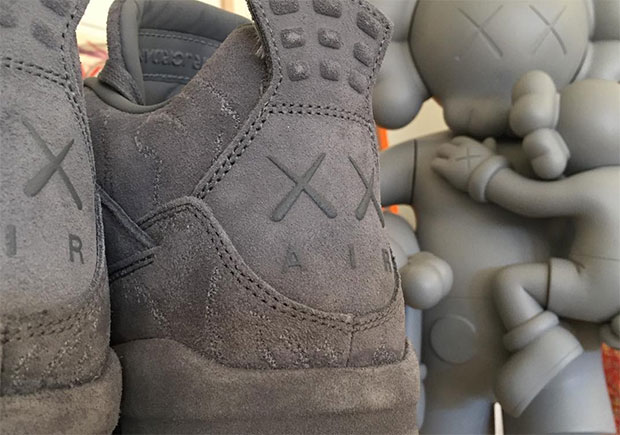 f4634b45889 First Look At The KAWS x Air Jordan 4 In Grey Suede