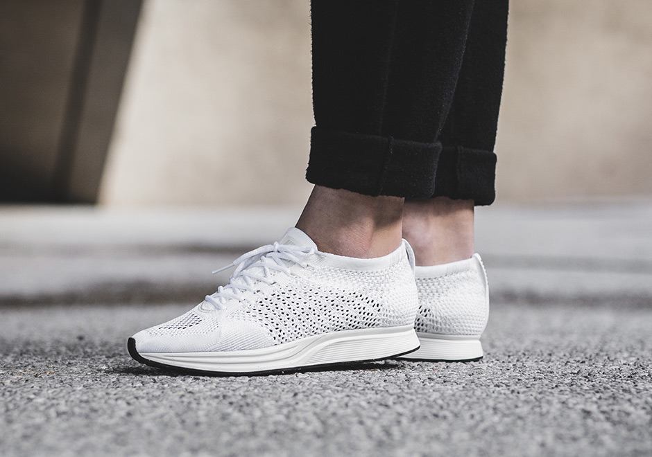 c5f9f63372f5d ... Nike Flyknit Racer Triple White On Foot Shop this Article Black ...