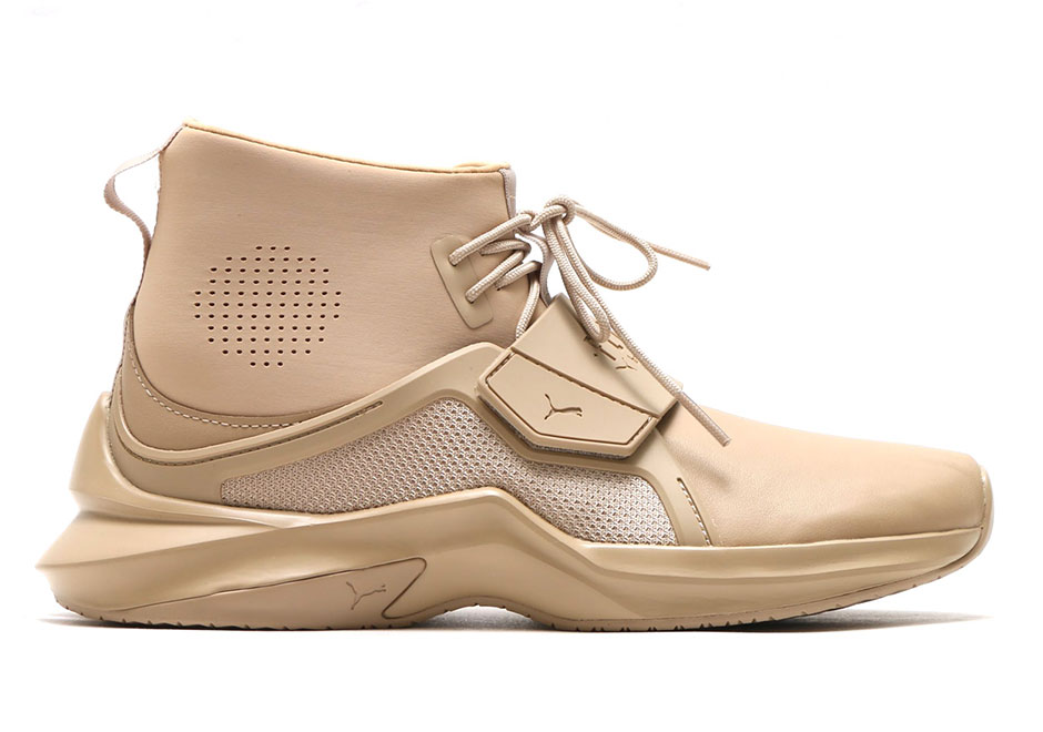 78ce9f0e6862c2 Rihanna s popular sneaker line with Puma gains another new silhouette this  summer with the Fenty Trainer Hi. Another thoroughly unique and stylishly  bold ...