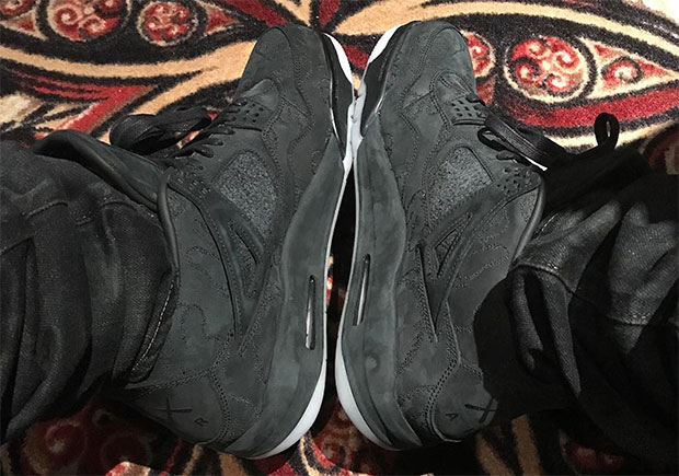 new style 32c92 710af Drake Reveals His Black KAWS x Air Jordan 4