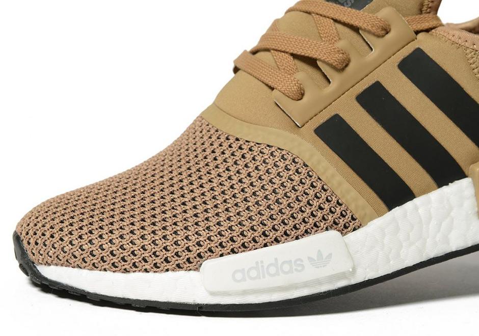 the latest 5e837 9ada8 adidas-nmd-r1-gold-black.jpg