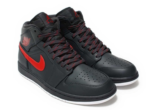 The Air Jordan 1 Mid Returns In Anthracite And Gym Red