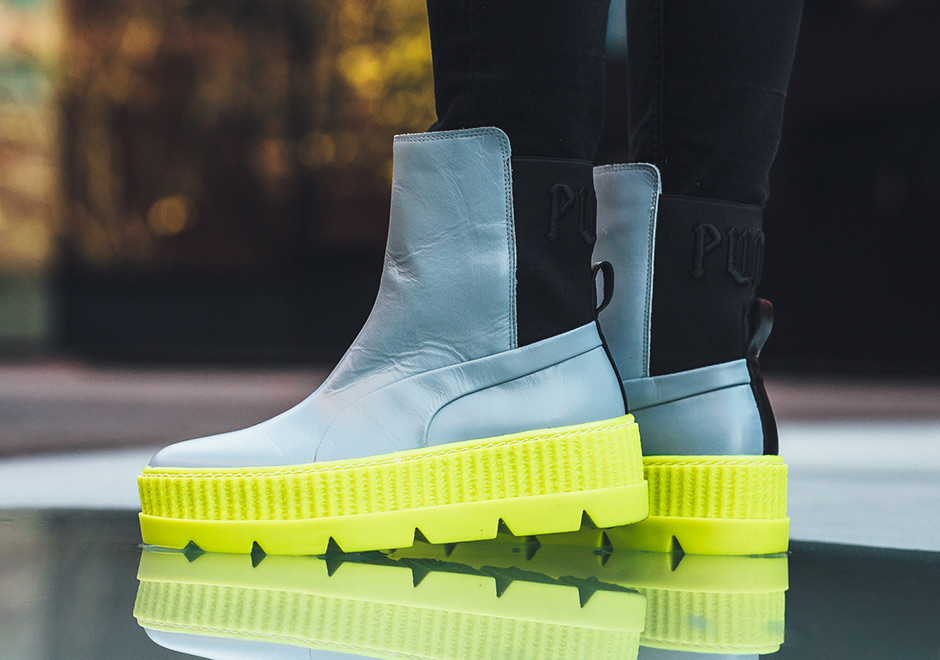 Rihanna and Puma are back with another addition to their FENTY collection  with this eye-catching Chelsea Sneakerboot. This boot borrows from the  updated ... 54c3bdb15