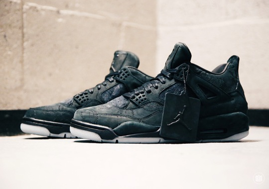 The KAWS x Air Jordan 4 In Black Is Releasing On Black Friday