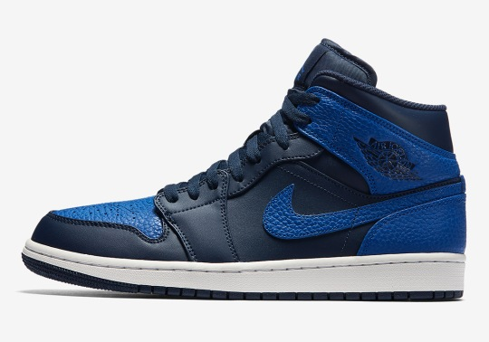 The Air Jordan 1 Mid Pairs Obsidian And Royal