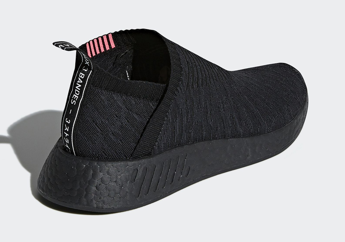 80d243892 adidas NMD CS2 Returns In Triple Black And Hits Of Solar Red