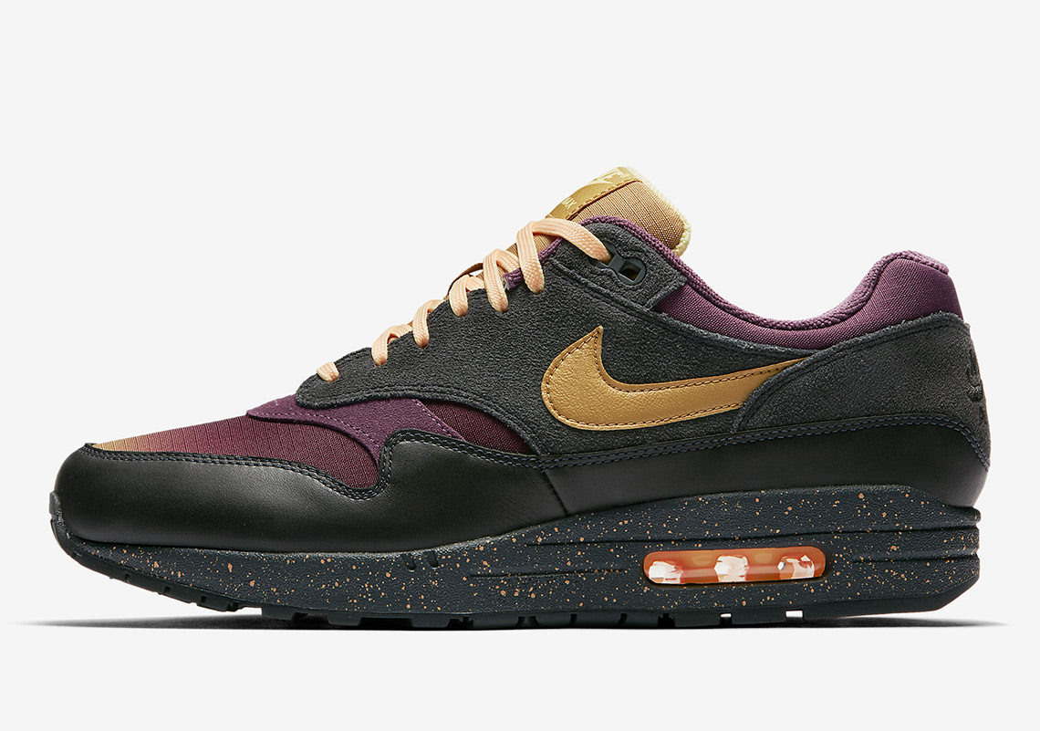Nike Air Max 1. AVAILABLE AT Nike $130. Color: Anthracite/Pro  Purple/Tangerine Tint/Elemental Gold Style Code: 875844-002
