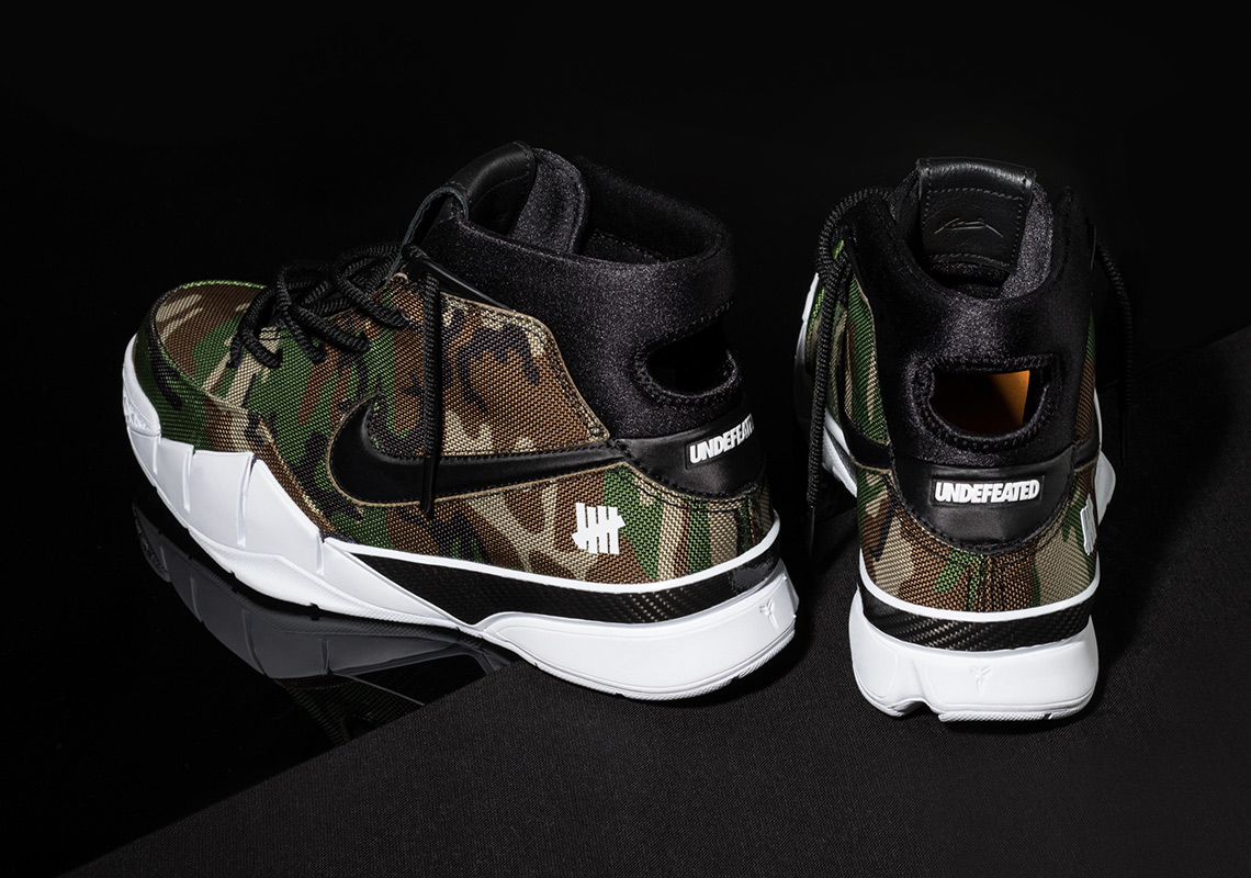 4dfb42acedc22 ... Camo GreenBlack Undefeated x Nike Zoom Kobe 1 Protro Release Date  February 16th, .