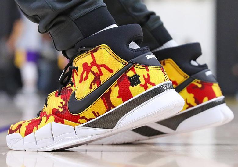 new styles 6ce97 69195 Isaiah Thomas Nike Zoom Kobe 1 Protro Yellow Camo  SneakerNe