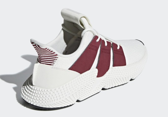 The adidas Prophere Adds Maroon Stripes