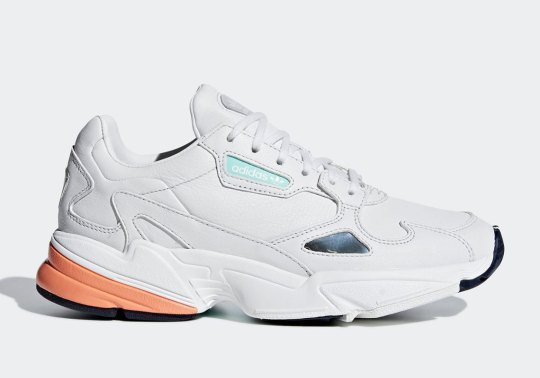 The adidas Falcon For Women Appears In A Crisp White And Orange