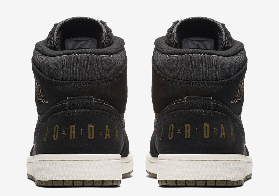 c36f20b2888 This Fleece-Tongued Air Jordan 1 Mid Features Another Classic Logo On The  Heel