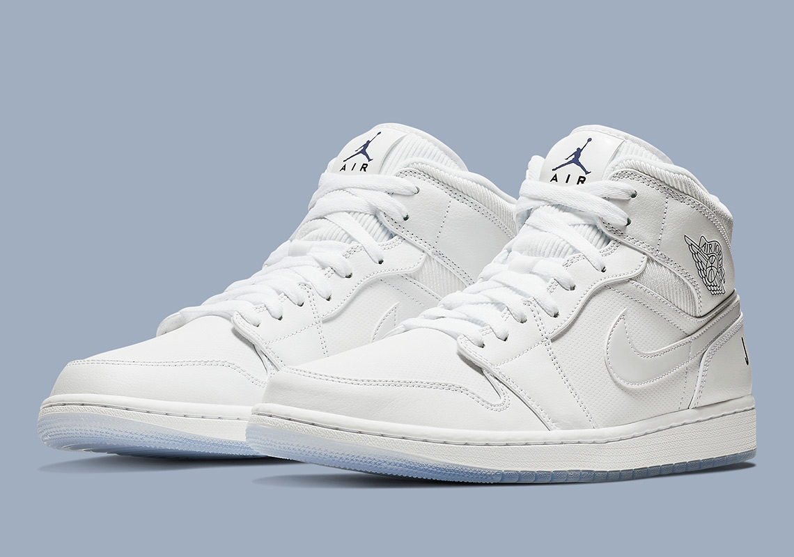 "84cca6802bd289 The Air Jordan 1 Mid ""Pure White"" Arrives With Heel Logos"