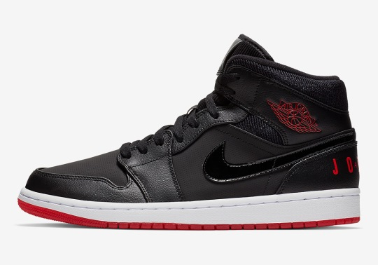 "The Air Jordan 1 Mid ""Bred"" Features Classic Logo On The Heel"