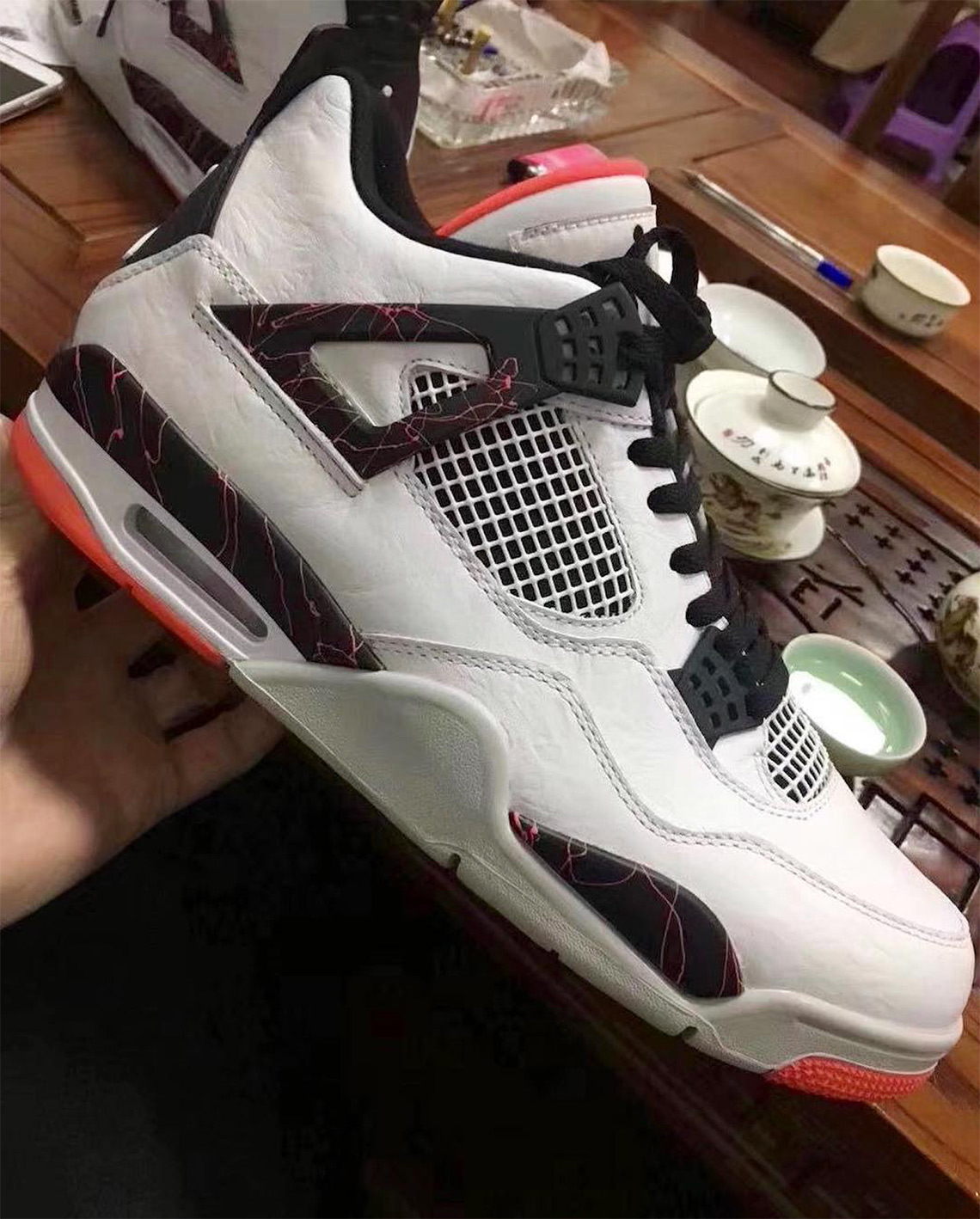 buy popular ca6d0 4c1cc Air Jordan 4 Light Crimson Release Info   SneakerNews.com