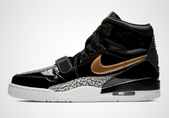The Jordan Legacy 312 Appears In Black And Gold Patent Leather