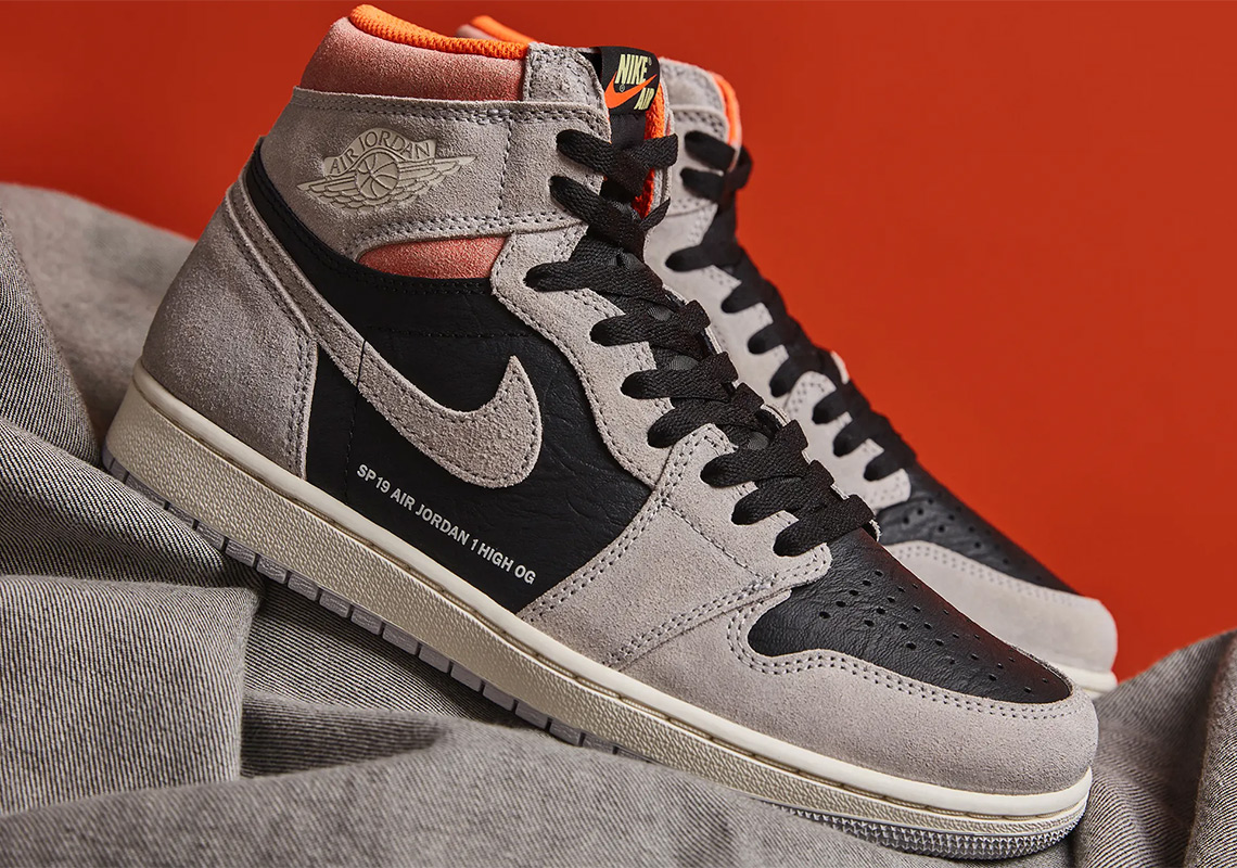 big sale ae520 02954 Jordan 1 Grey Black Crimson 555088-018 Store List   SneakerNews.com