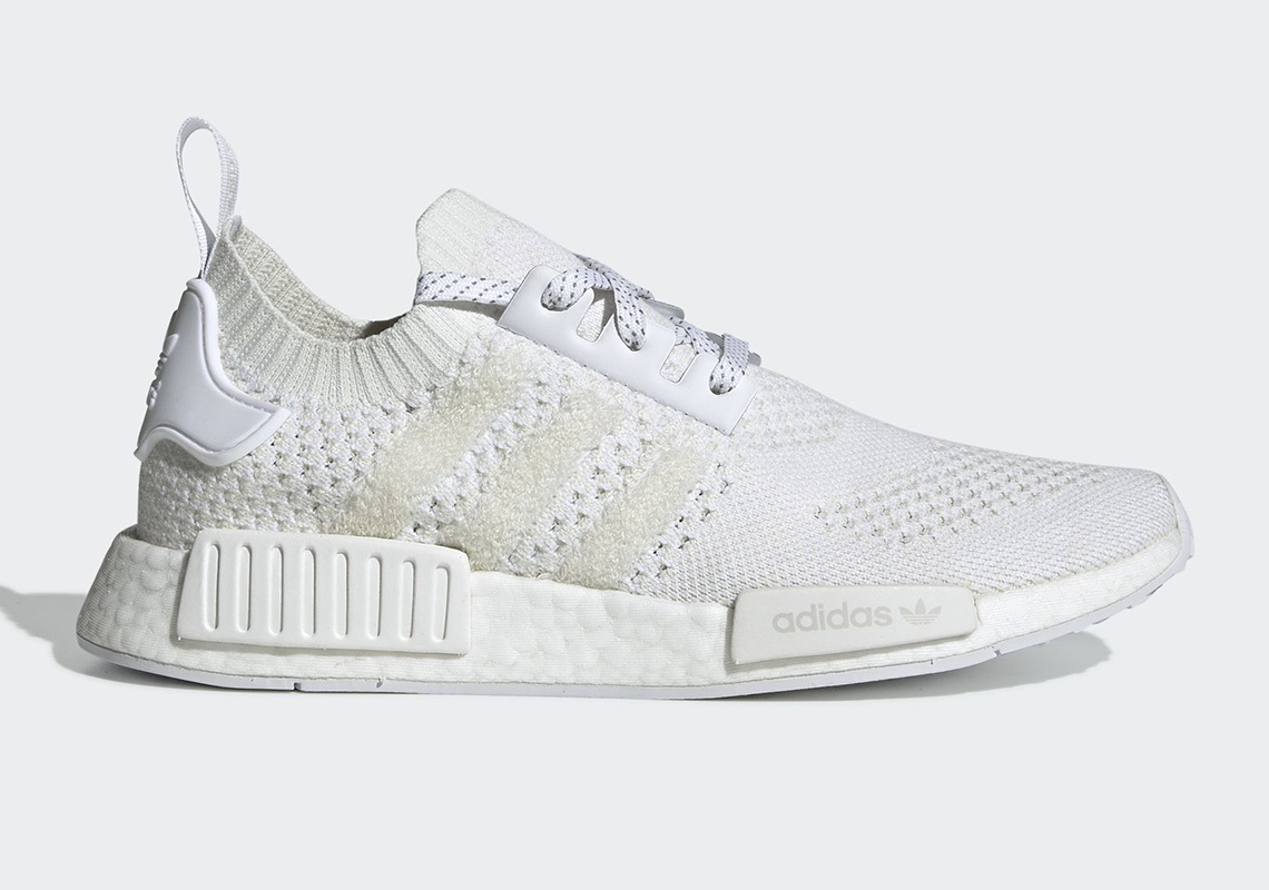 """7ca7e283b The adidas NMD R1 """"Triple White"""" Returns With A Familiar Pattern"""