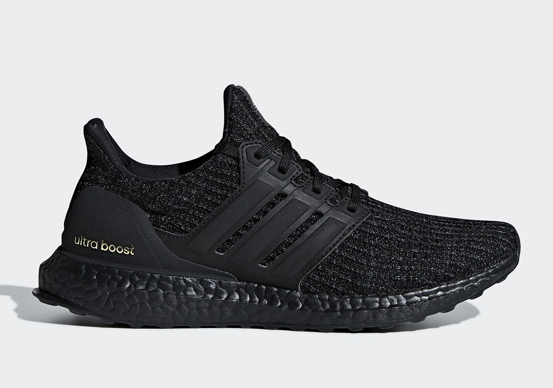 """6b462eb341e2b adidas Ultra Boost 4.0 """"Triple Black"""" Arrives With Gold Accents"""