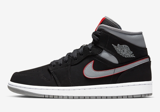 The Air Jordan 1 Mid Returns In A Classy Black, Red, And Grey