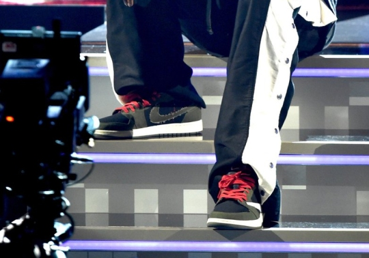 Travis Scott Debuts His Air Jordan 1 Low At Grammy Awards