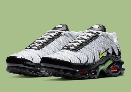 check out 78a64 2f8db Nikes Air Max Plus Is Releasing With Bold Volt And Red Accents