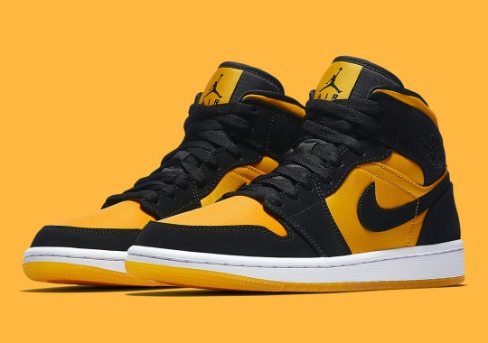 ce744fa88 The Air Jordan 1 Mid Appears In Black And University Gold