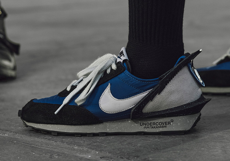 half off a0deb e22dc Jun Takahashi s UNDERCOVER adds a bold plastic spoiler to the heel of Nike s  old-school Daybreak for their latest collaborative effort. READ MORE