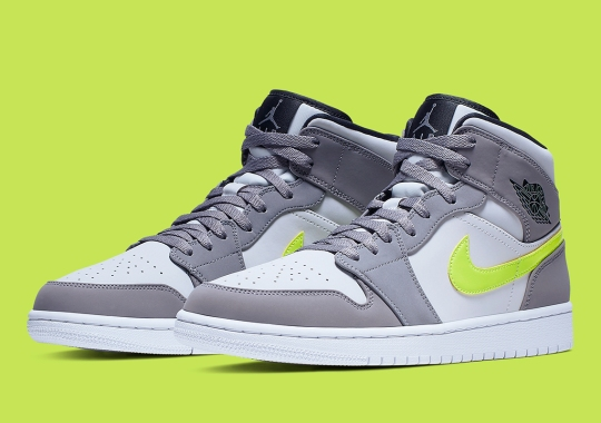 The Ubiquitous Air Jordan 1 Mid Appears In Grey And Volt