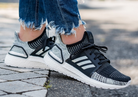 This adidas Ultra Boost 19 For Women Pairs Black With Soft Green Primeknit