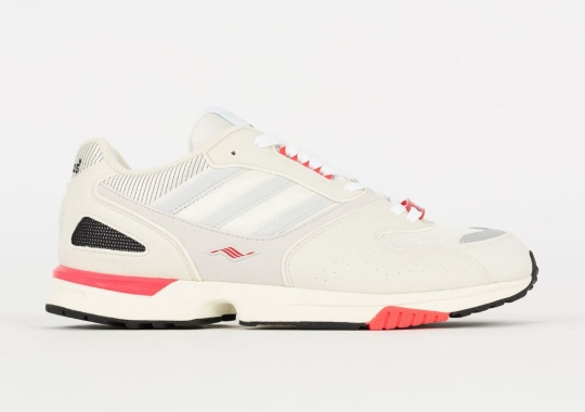 Off White And Coral Accents Appear On This Women's adidas ZX4000