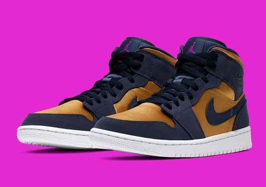 The Air Jordan 1 Mid Pairs Navy With A Satin Gold Finish