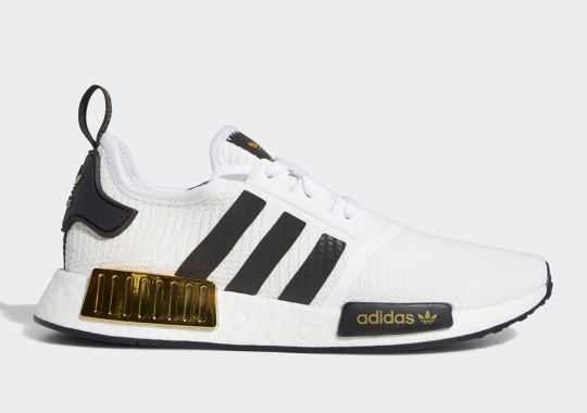 The adidas NMD R1 Gets Glossy Metallic Gold Bumpers